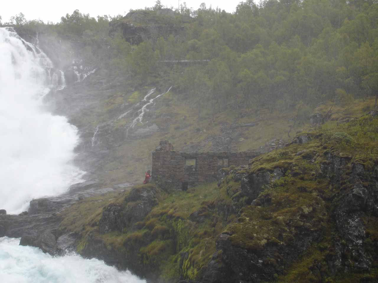 Looking at one of the ladies retreating to the stone ruins besides Kjosfossen
