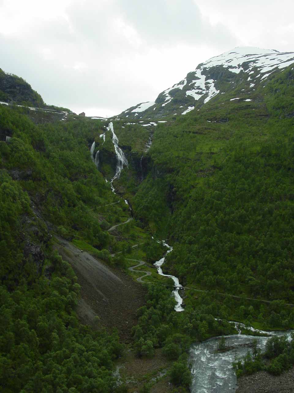 Impressively tall waterfall we've informally called 'Myrdalsfossen' tumbling alongside a twisty local road high up in Flåmsdalen Valley