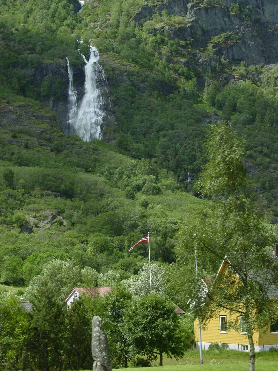 Brekkefossen fronted by some homes of Flamsdalen
