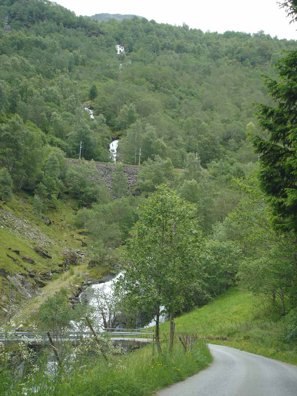 Looking back at some of the twisty narrow roads and cascades tumbling beneath them during our self-tour of Flamsdalen