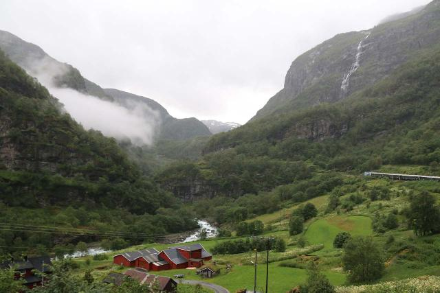 Flam_Railway_132_07222019 - The visitor center office in Flåm lets you book excursions including the cruise mentioned on this page or the Flåm Railway among others.  This picture shows some of the idyllic valleys that the railway would expose you to
