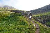 Flogufoss_036_08092021 - Mom climbing up this fairly steep ridge to improve the view of Flögufoss