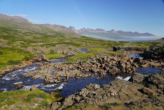 Folaldafoss_027_08092021 - Context of the Berufjarðará as it tumbles downstream from Folaldafoss towards the Berufjörður in the distance