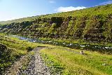 Forsaedalur_043_08162021 - Context of Julie and Tahia rounding a bend and approaching downstream towards Stekkjarfoss