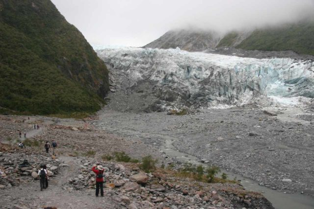 Fox_Glacier_026_12262009 - Julie and many other hikers walking closer to the terminus of the Fox Glacier