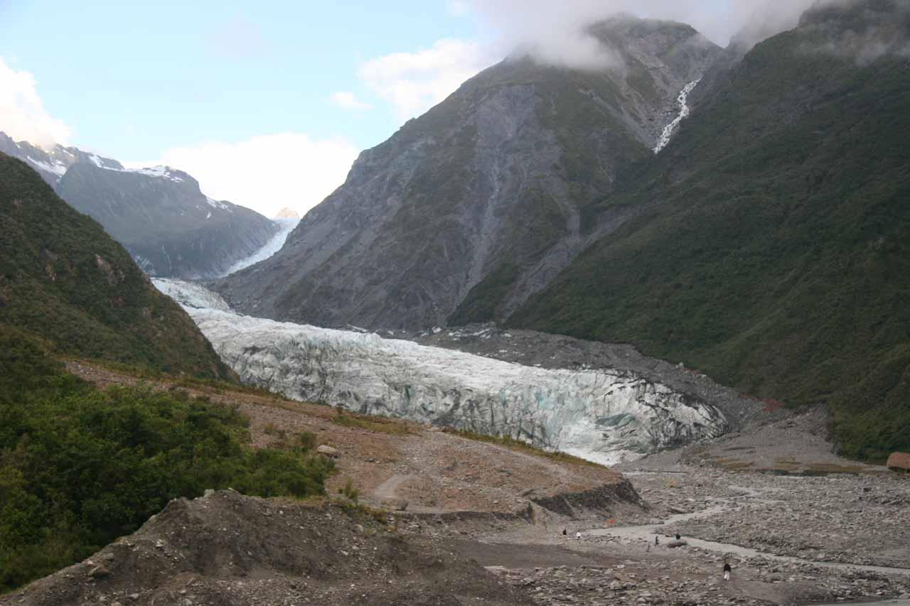Contextual view of a cascade spilling towards the Fox Glacier as seen in December 2009
