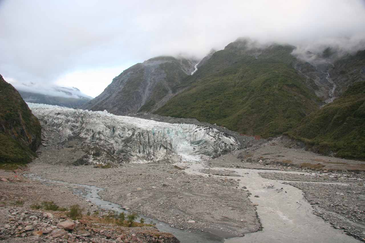 Context of the Fox Glacier with the Fox River and some cascades tumbling towards it