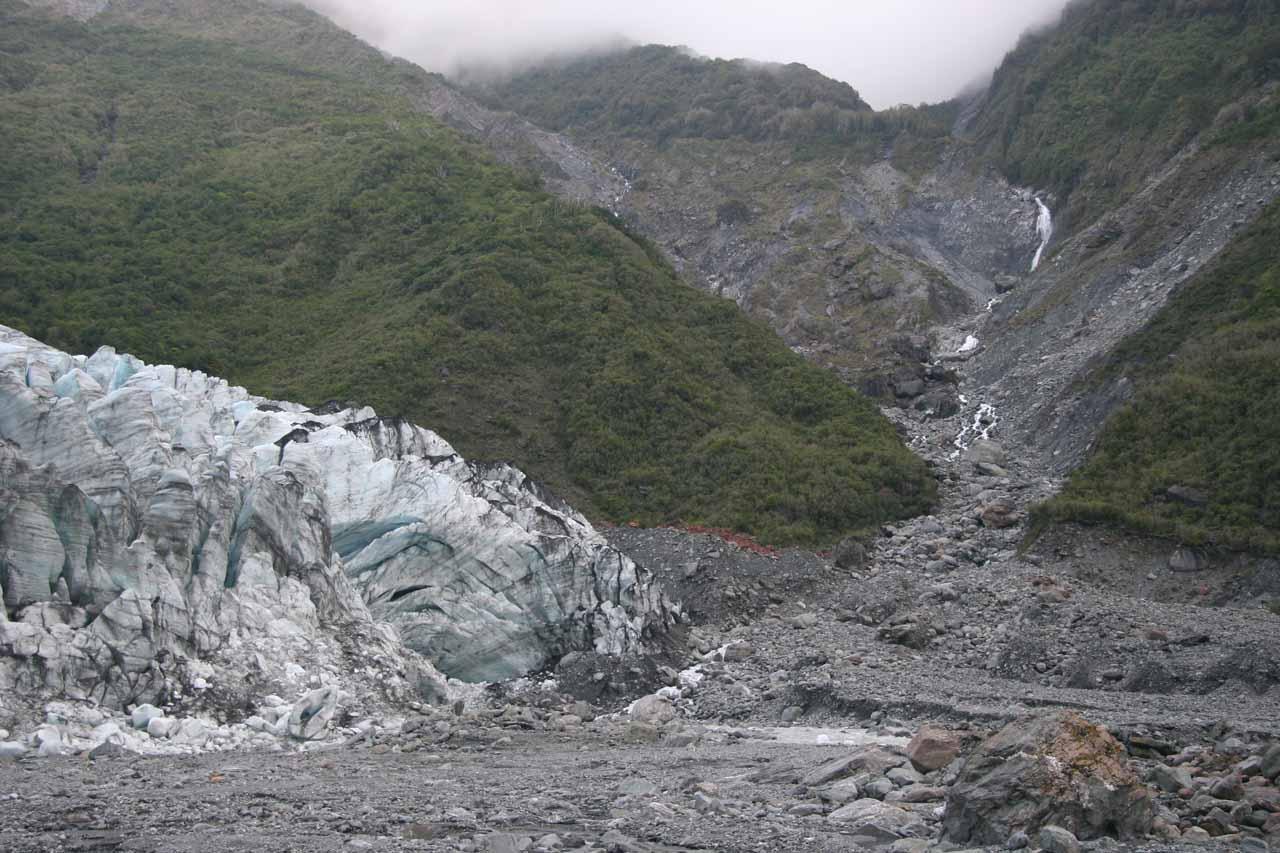 Looking across the terminus of Fox Glacier towards a cascade