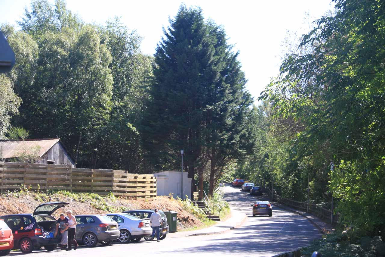 Perhaps this photo conveys the nature of the single-track B852 road as well as some of the limited parking at the Waterfall Cafe.  Note some of the cars parked further outside town