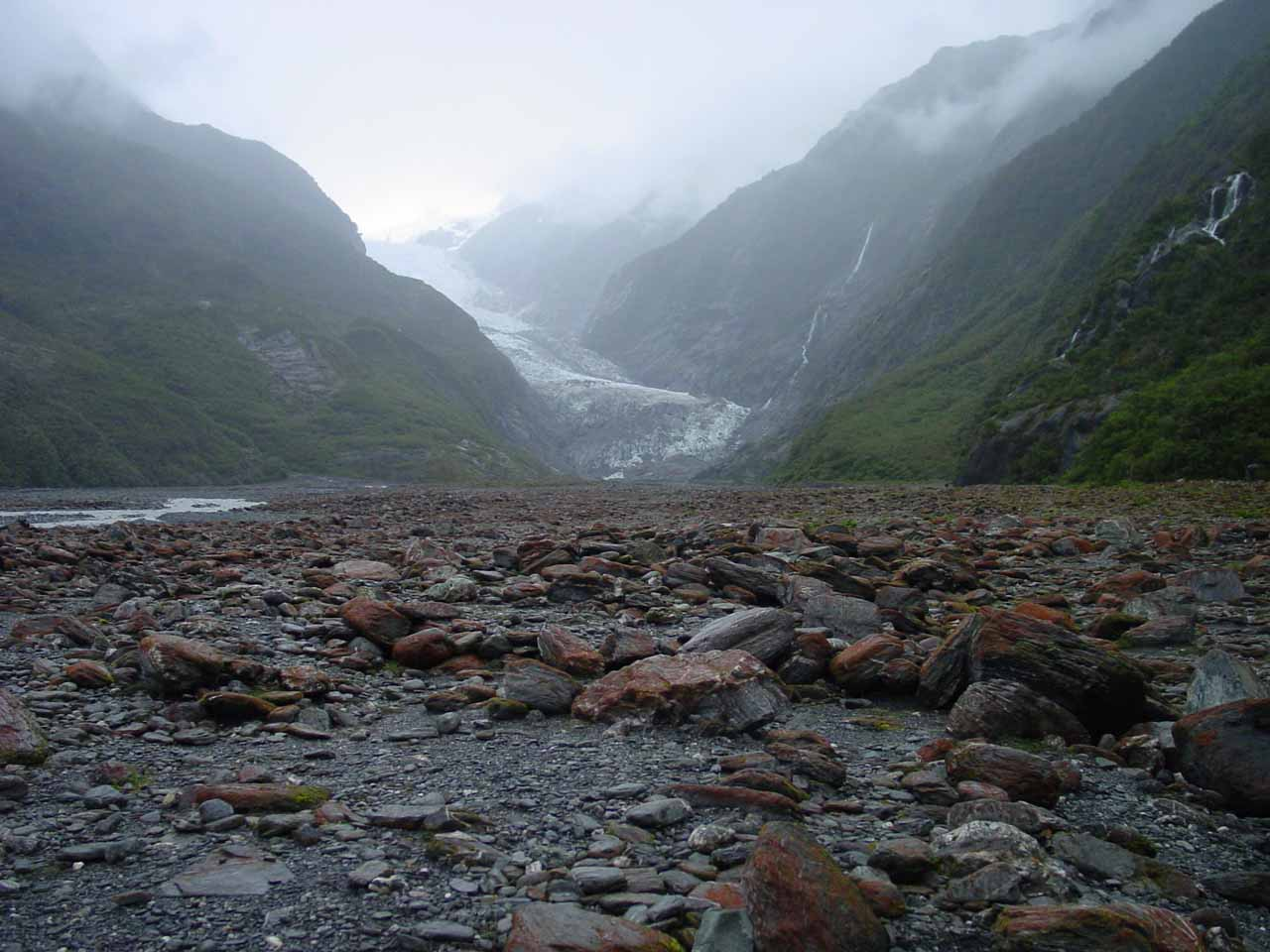 Walking amidst a jumble of boulders towards the terminus of the Franz Josef Glacier