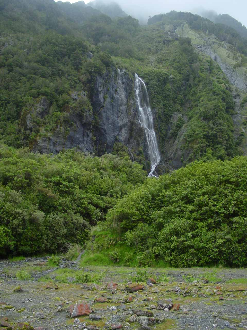 Looking towards one of the waterfalls seen early on in the valley of the Franz Josef Glacier