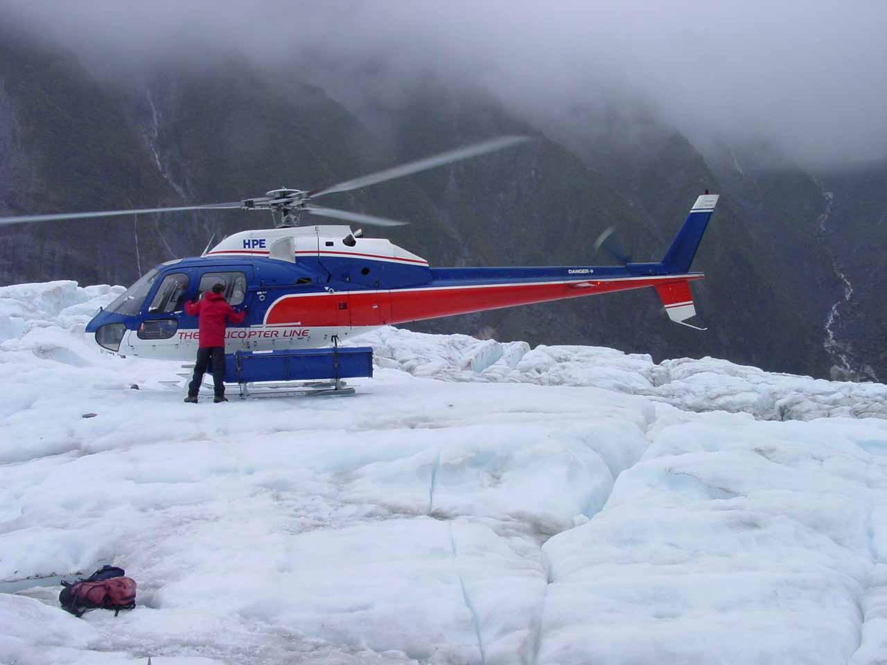The chopper landing on the glacier