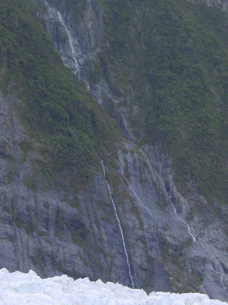 One of several thin waterfalls spilling into the Franz Josef Glacier