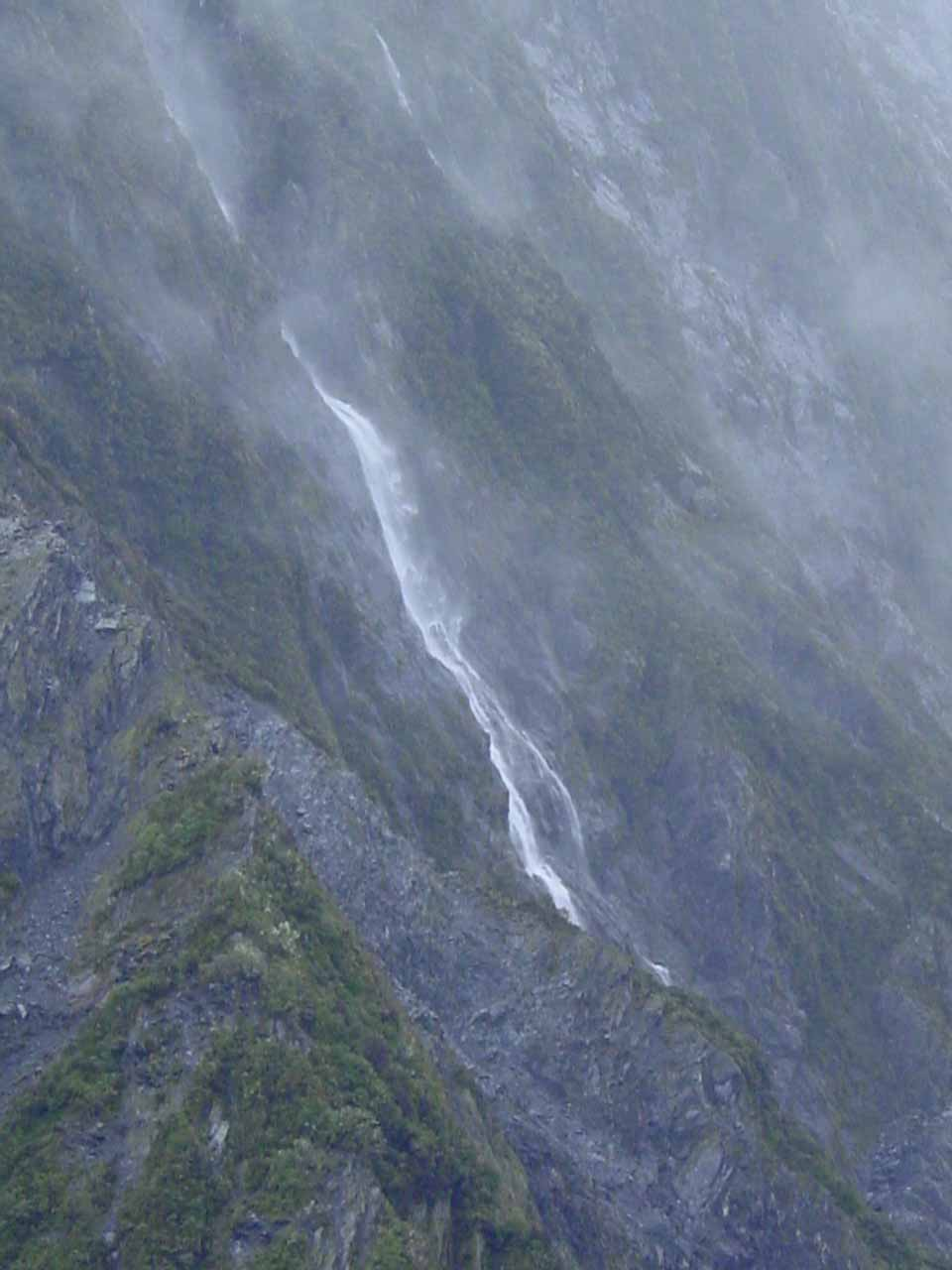 Closeup look at what I think is Unser Fritz Falls tumbling into the Franz Josef Glacier
