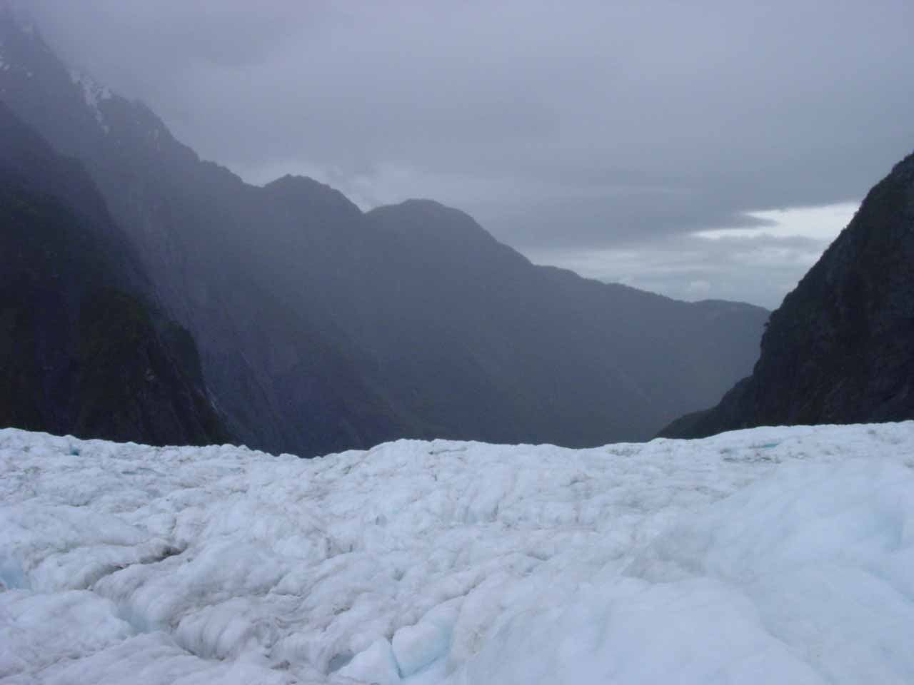 Looking down the Franz Josef Glacier at the weather that we had to contend with on that day