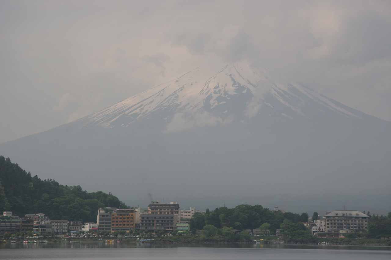Fuji towering over some buildings at its base