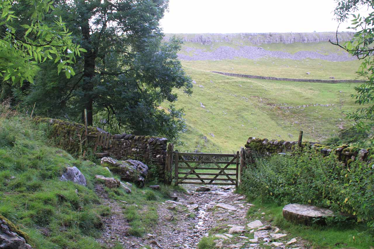 Crossing through another one of the sheep fences or stiles as the trail continued to climb up towards the moors