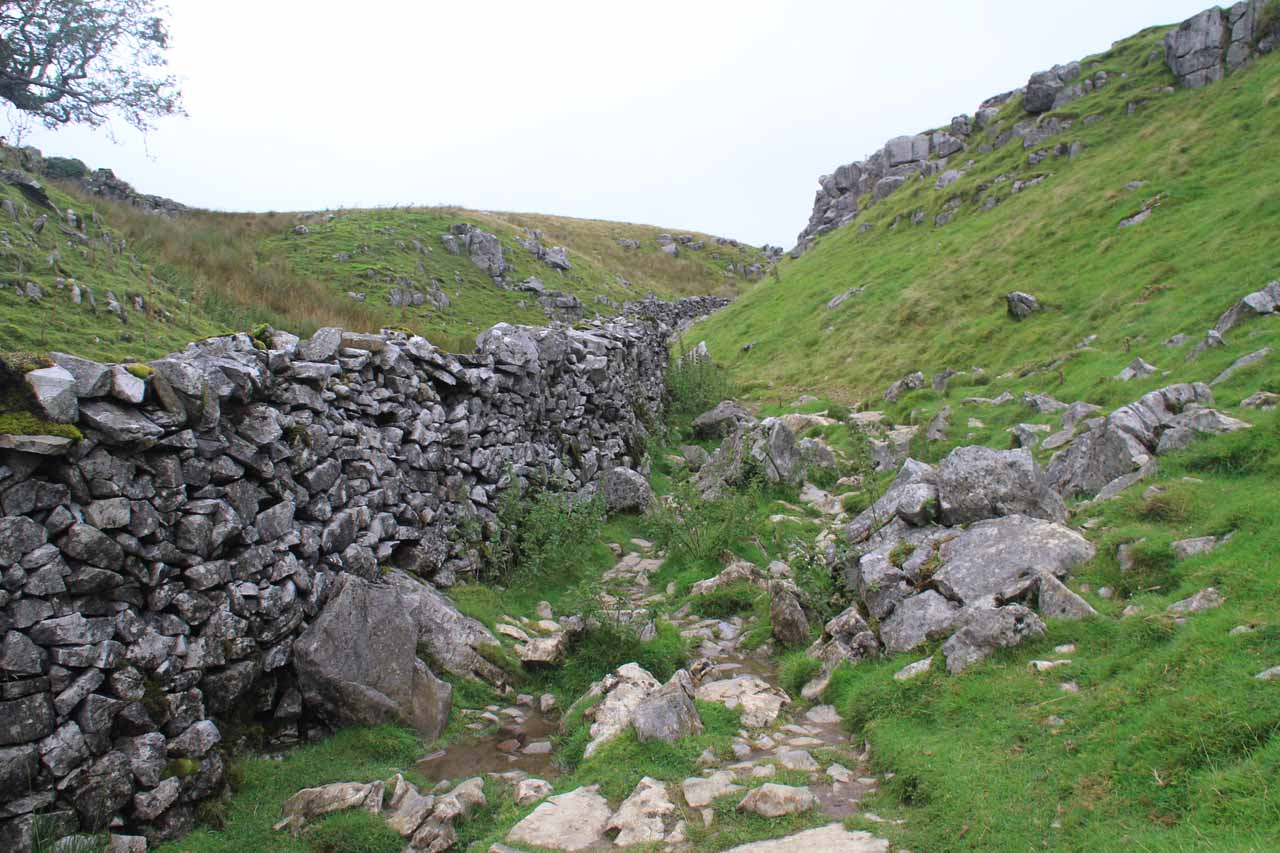 Rough and uneven ground as I was following one of the sheep walls in the moors