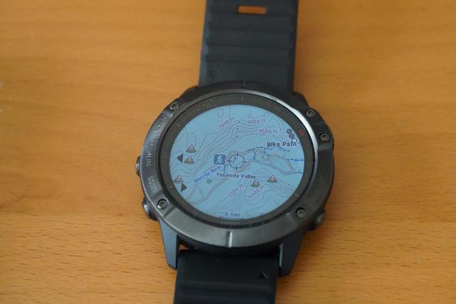 Looking at the watch face of my Garmin Fenix 6X Pro Sapphire in map mode, which I found to be pretty amazing to think that I can do this on a wristwatch!