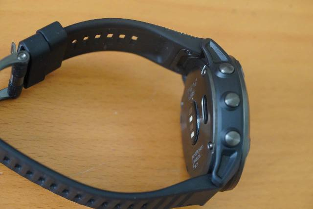 Closer look at three of the five buttons on the Garmin Fenix 6X Pro watch (the other two are on the other side)