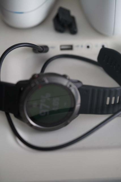 My Garmin Fenix 6X Pro Sapphire watch connected to my desktop computer via the USB interface