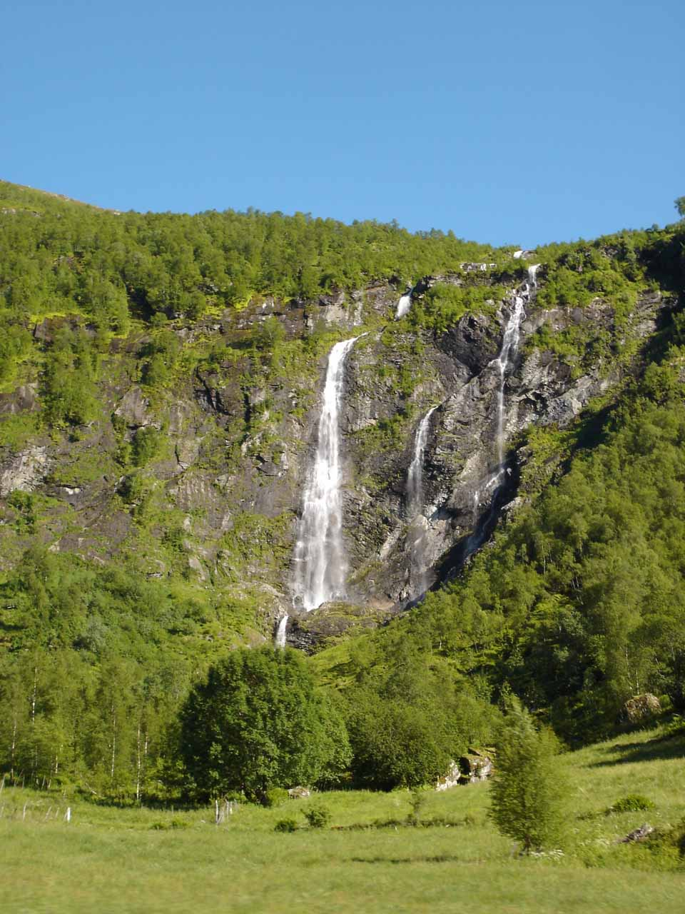 An attractive but light-flowing free-falling waterfall on the north-facing cliffs by Viksdalvatnet