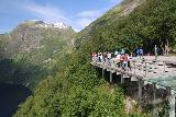 Geiranger_006_07182019 - Looking towards the lookout platform in context with Bringefossen and part of Geirangerfjorden from Ornesvingen