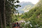 Geiranger_311_07182019 - Looking down at the steps and the context of the cascading waterfalls with Geirangerfjord in the distance