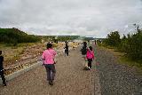 Geysir_009_08062021 - The family walking closer to Strokkur and Geysir