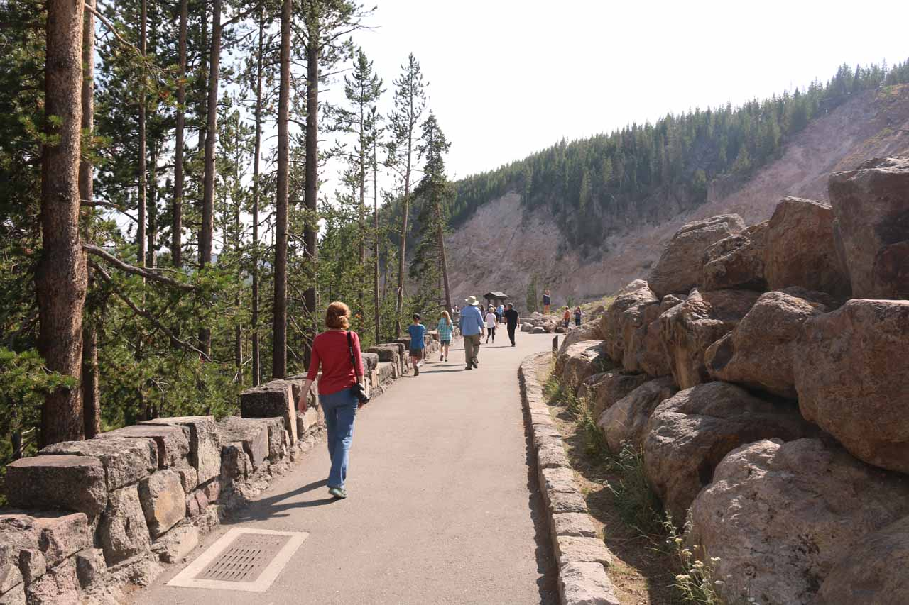 Following along the wide and paved walkway for Gibbon Falls