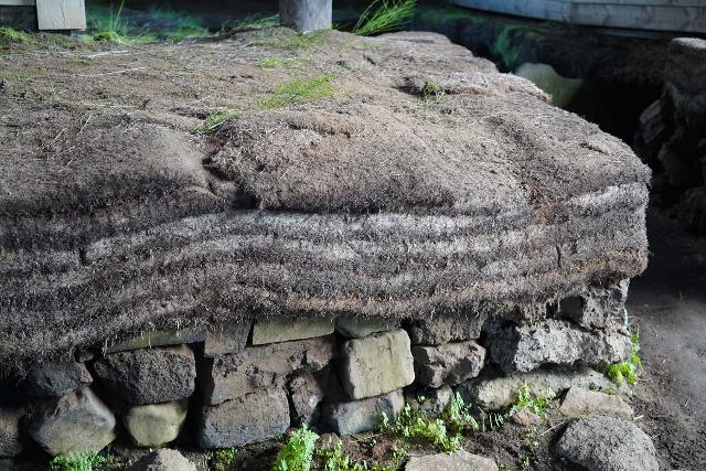 Gjain_037_08202021 - Closeup look at the turf layers on display inside the Stöng Farm though they weren't part of the original structure that was here during Iceland's Settlement Era