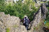 Gjain_078_08202021 - Mom descending a somewhat hidden path down towards the pool before Gjarfoss