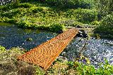 Gjain_156_08202021 - Going across a footbridge to get all the way across the segments of the Rauda Stream in Gjain