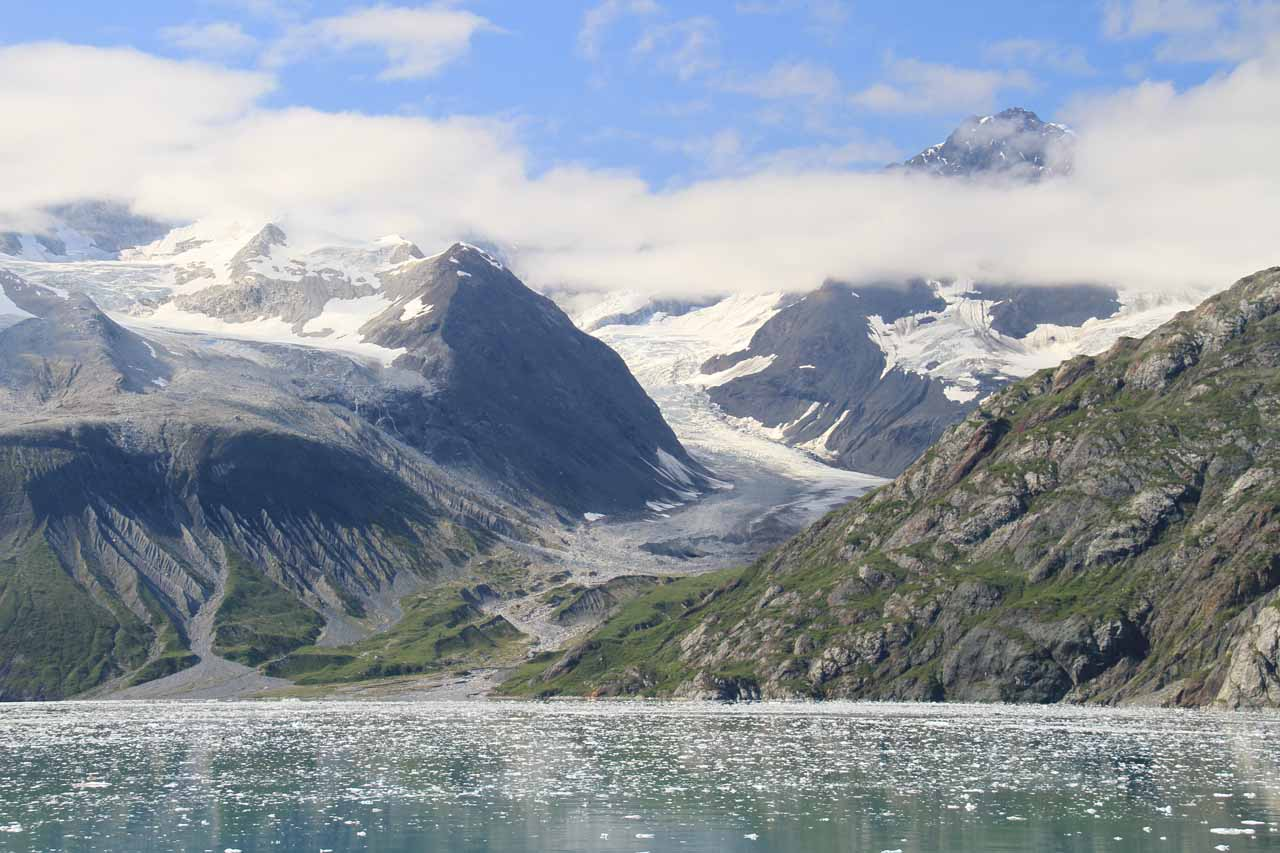 Another surreal scene of a glacier steeply falling towards Glacier Bay