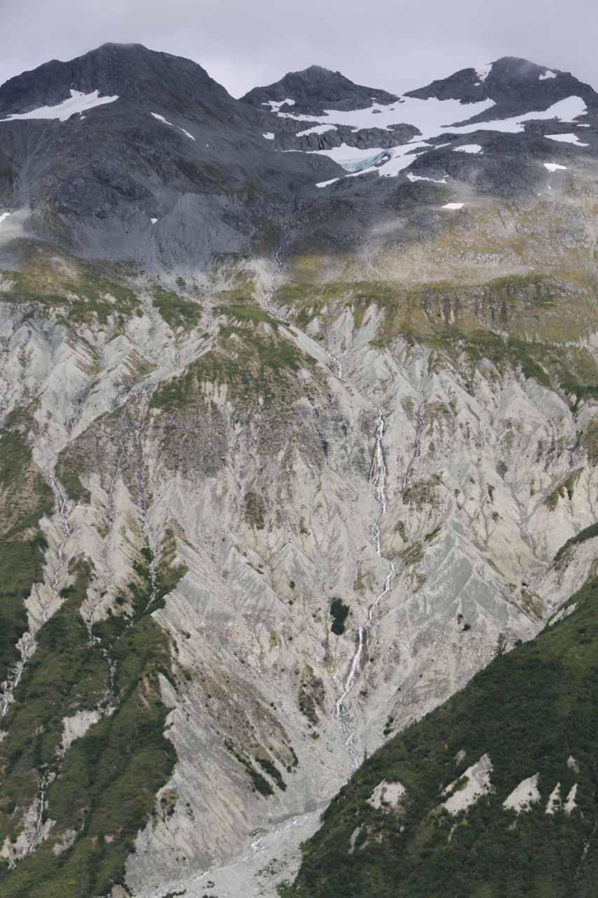 Thin cascade tumbling amidst a bare cliff