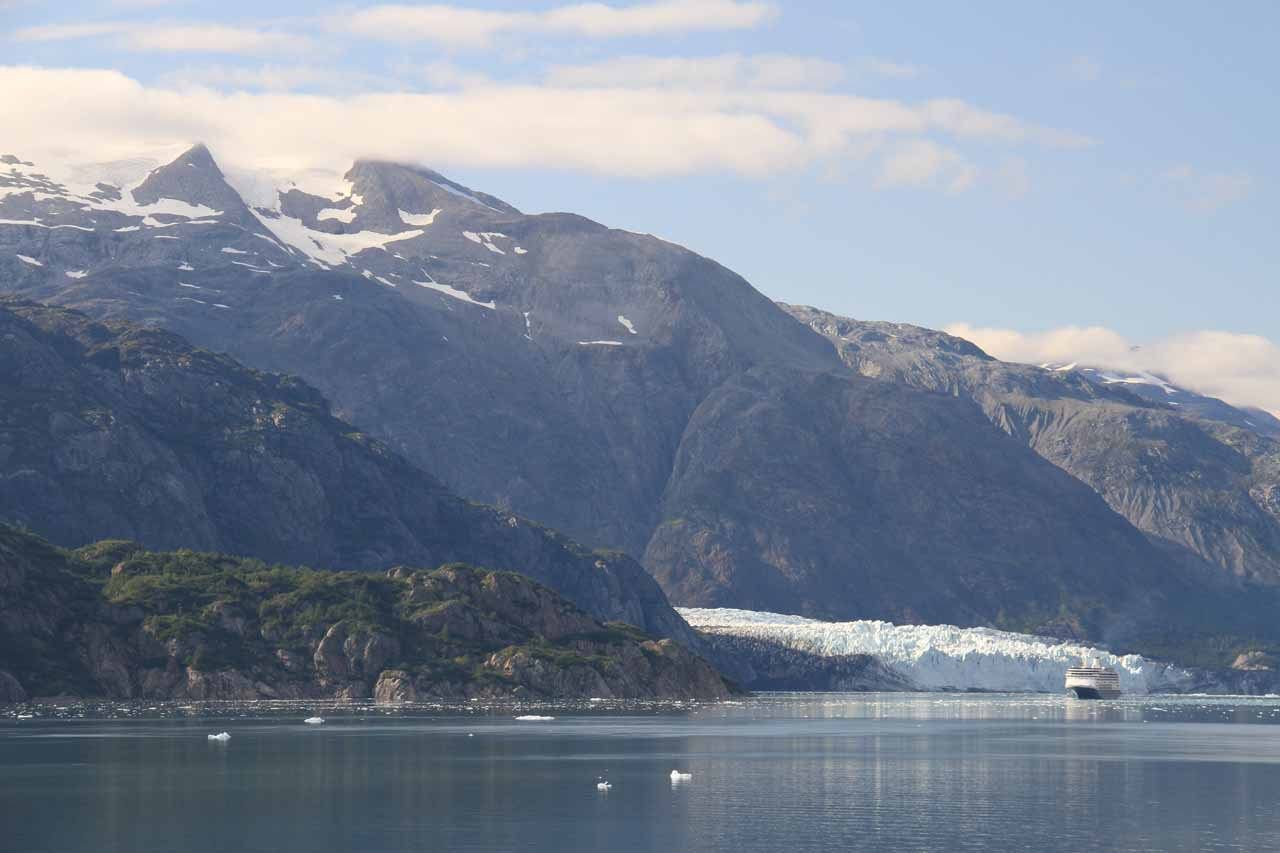 A cruise ship passing before the terminus of the Margerie Glacier, which shows just how tall the glacier terminus is given how big these cruise ships are
