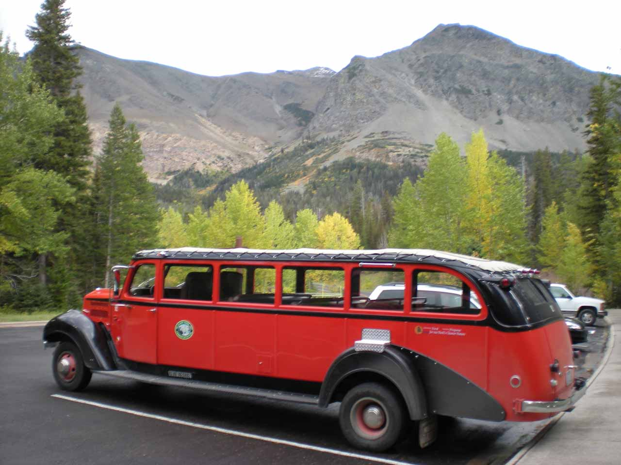 A red tour bus we saw at the trailhead for Running Eagle Falls