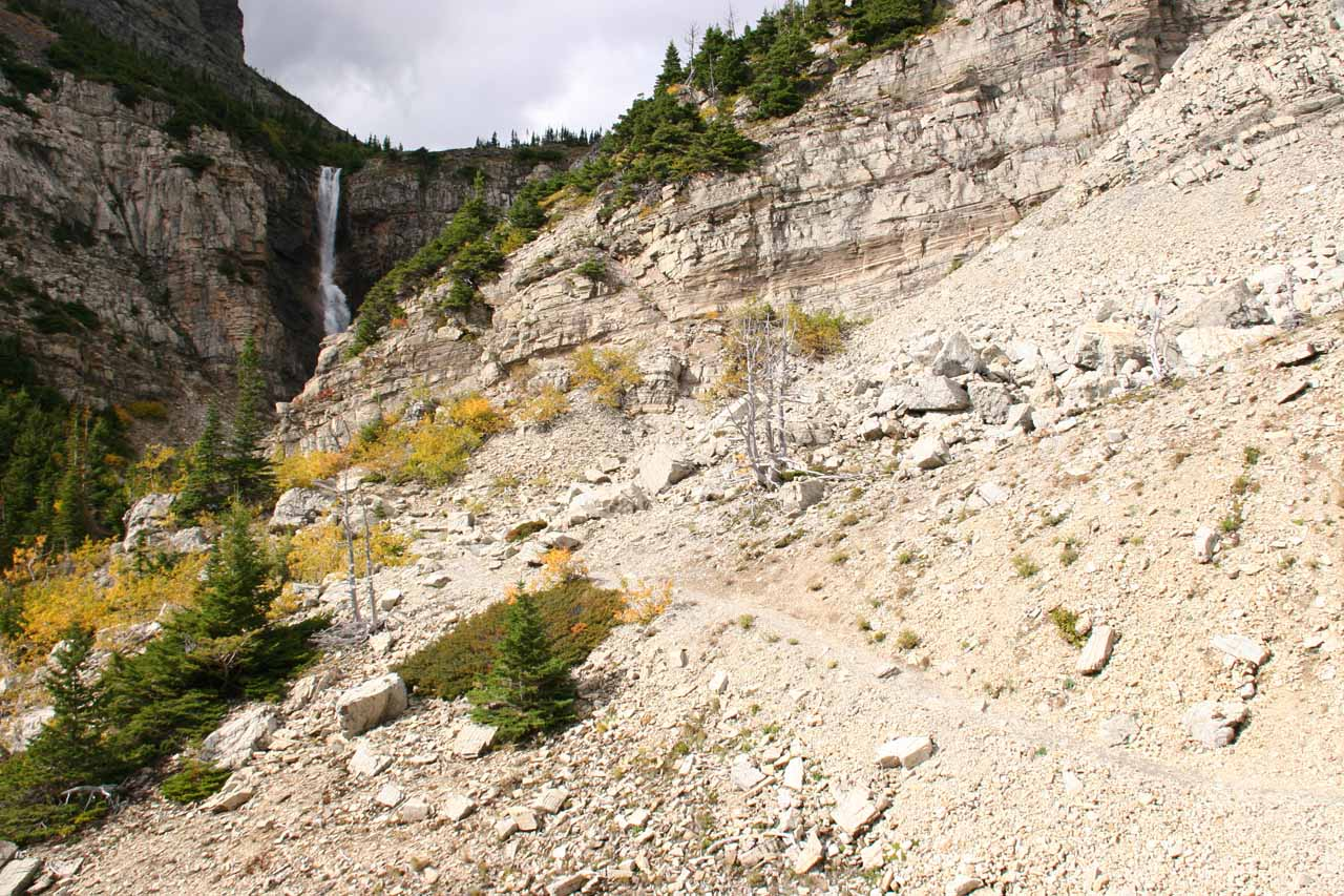 Approaching Apikuni Falls along a loose scree slope