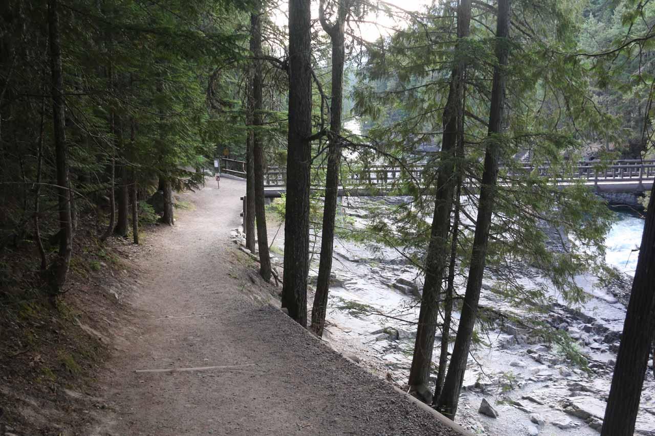 Walking alongside McDonald Creek towards the footbridge
