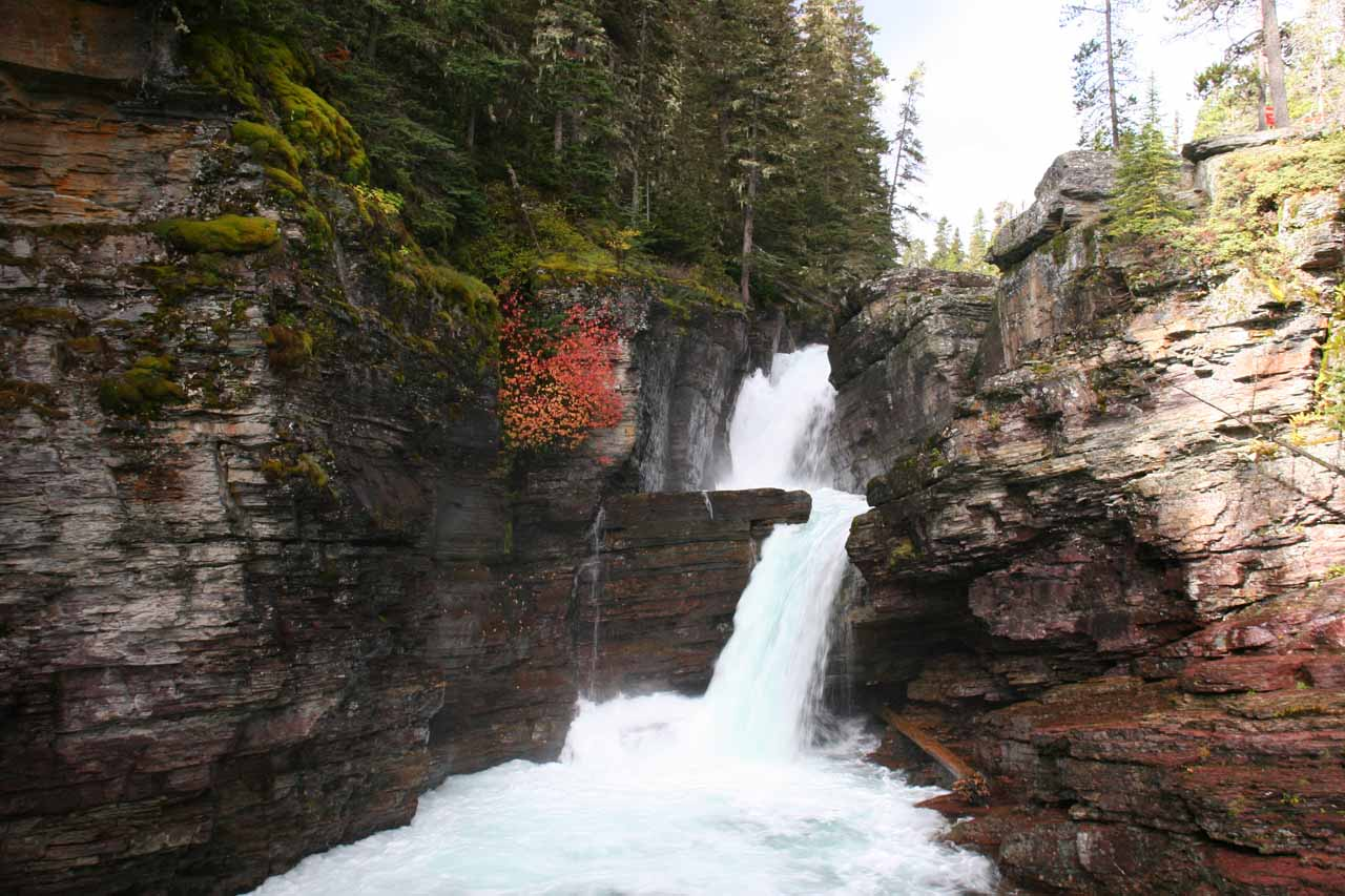 Direct view of St Mary Falls with a hint of some Fall colors in September 2010