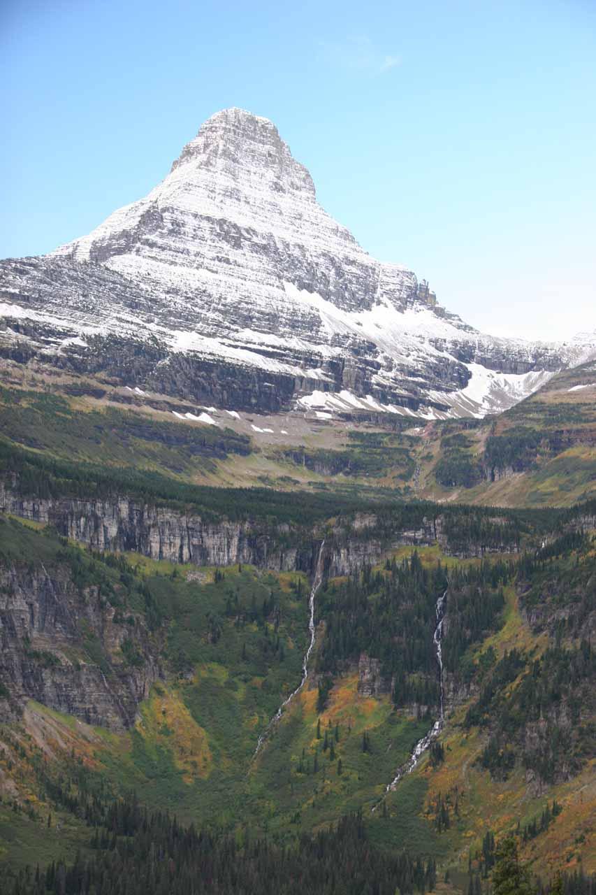Contextual view of pair of cascades beneath a peak as we got closer to Logan Pass