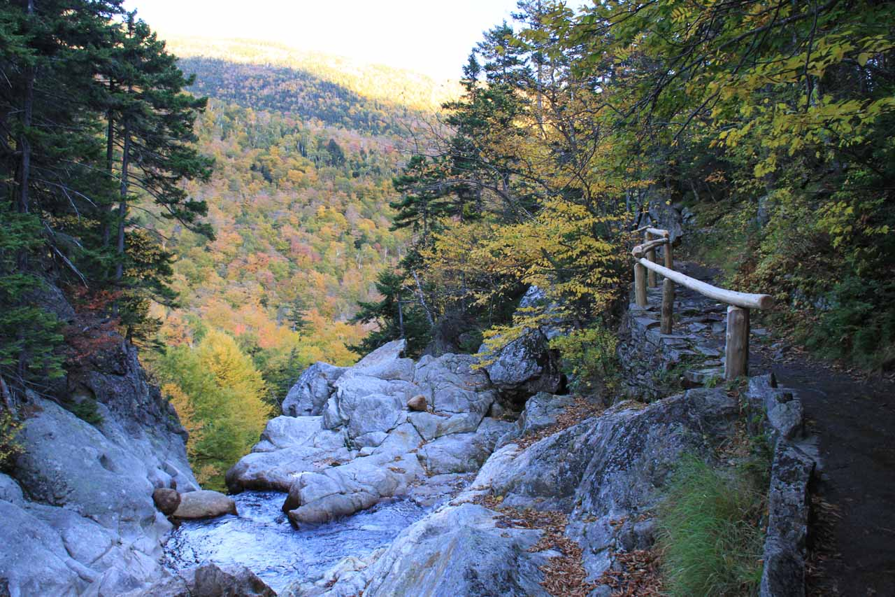 Looking over the top of Glen Ellis Falls towards Autumn foliage