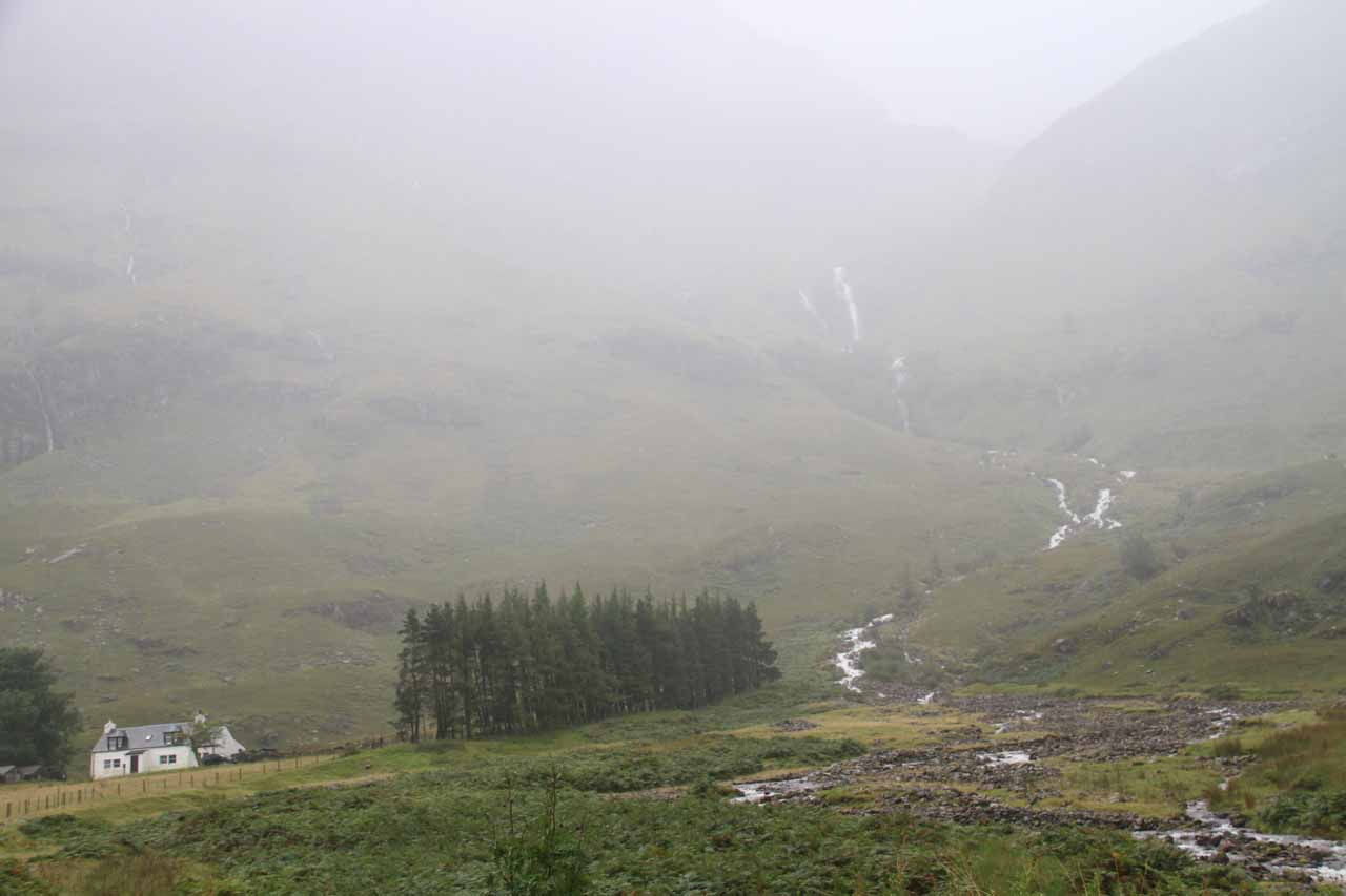 Full context of the mysterious waterfall at the mouth of Glencoe Valley from a small car park