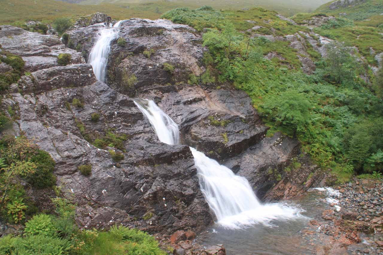 Looking down at the slanted cascade called the Falls of Glencoe at the head of Glencoe Valley