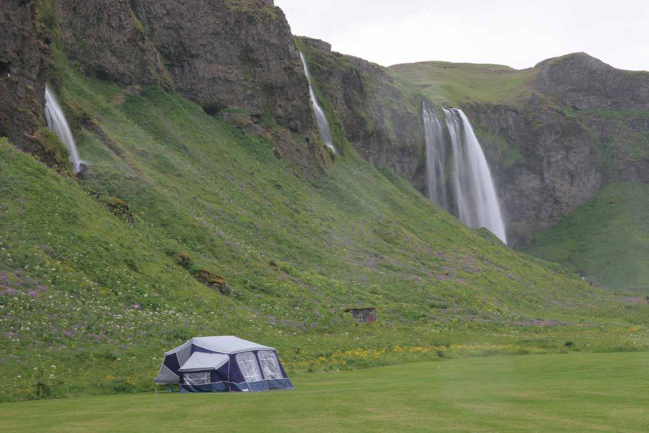 Looking over someone camping between Gljúfurárfoss and Seljalandsfoss, which is the one in the distance past the tent