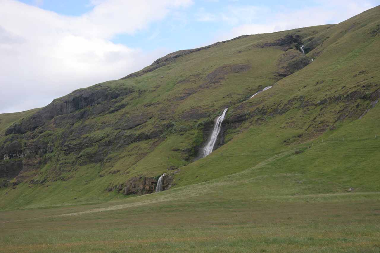 Looking west towards another cascading multi-tiered waterfall from Gluggafoss
