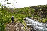 Glymur_041_08052021 - Mom hiking alongside the rushing Botnsa River