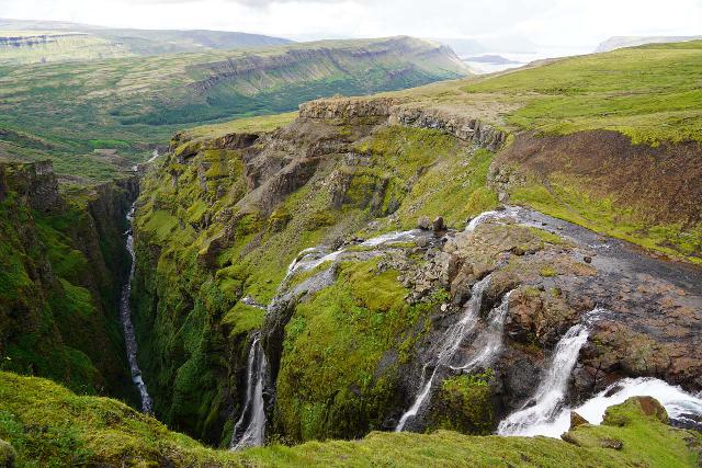 Glymur_246_08052021 - Context of the brink of Glymur spilling into Glymsgljúfur Canyon with Hvalfjörður in the distance