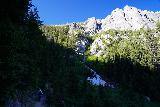 Goat_Falls_and_Lake_hike_100_06172021 - Another look at the context of the Alpine Way Trail with the Sawtooth Mountains looming above us while still having some snow in its drainages during our mid-June 2021 visit
