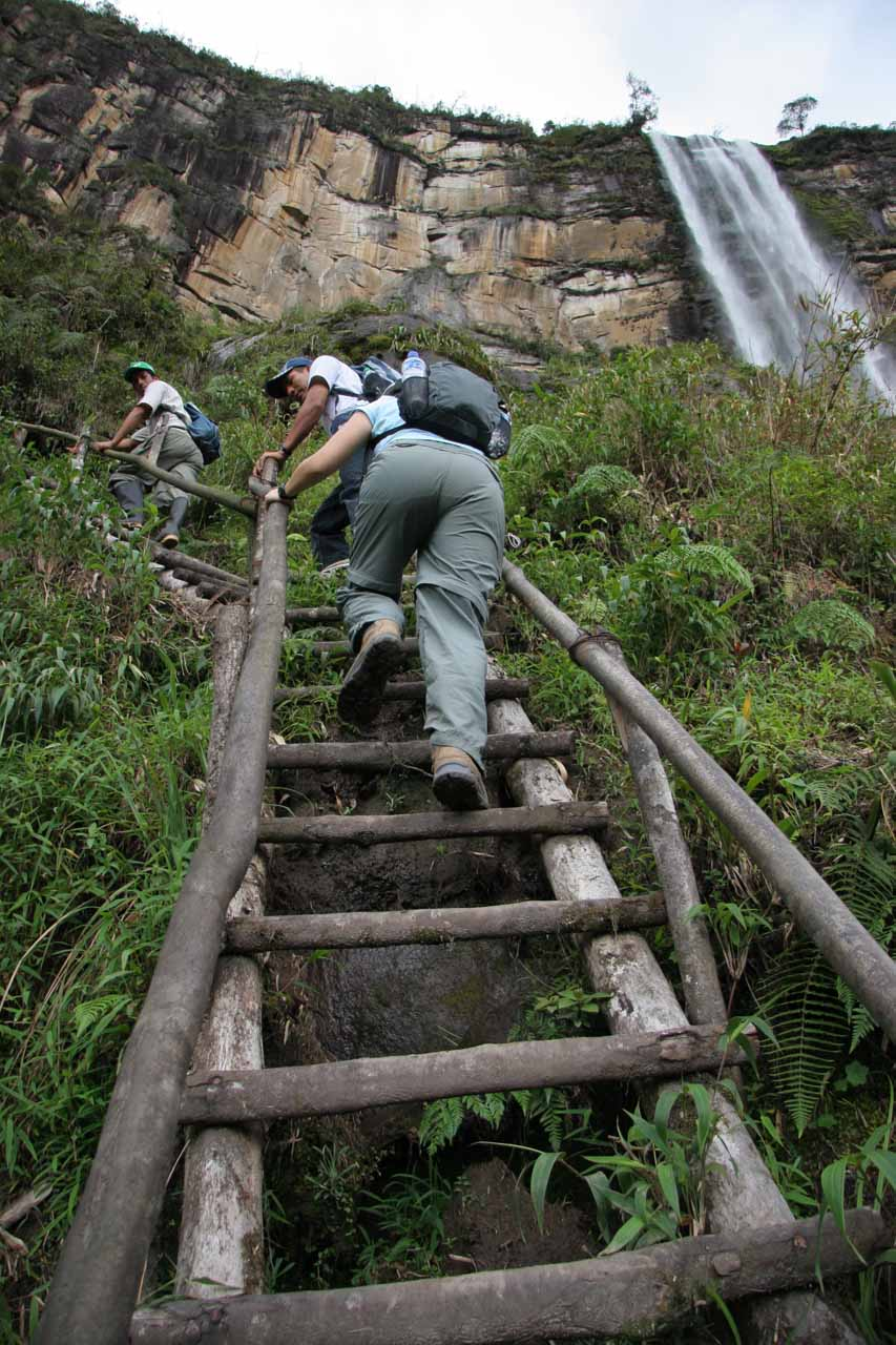 Climbing up a ladder for a better look at the upper waterfall